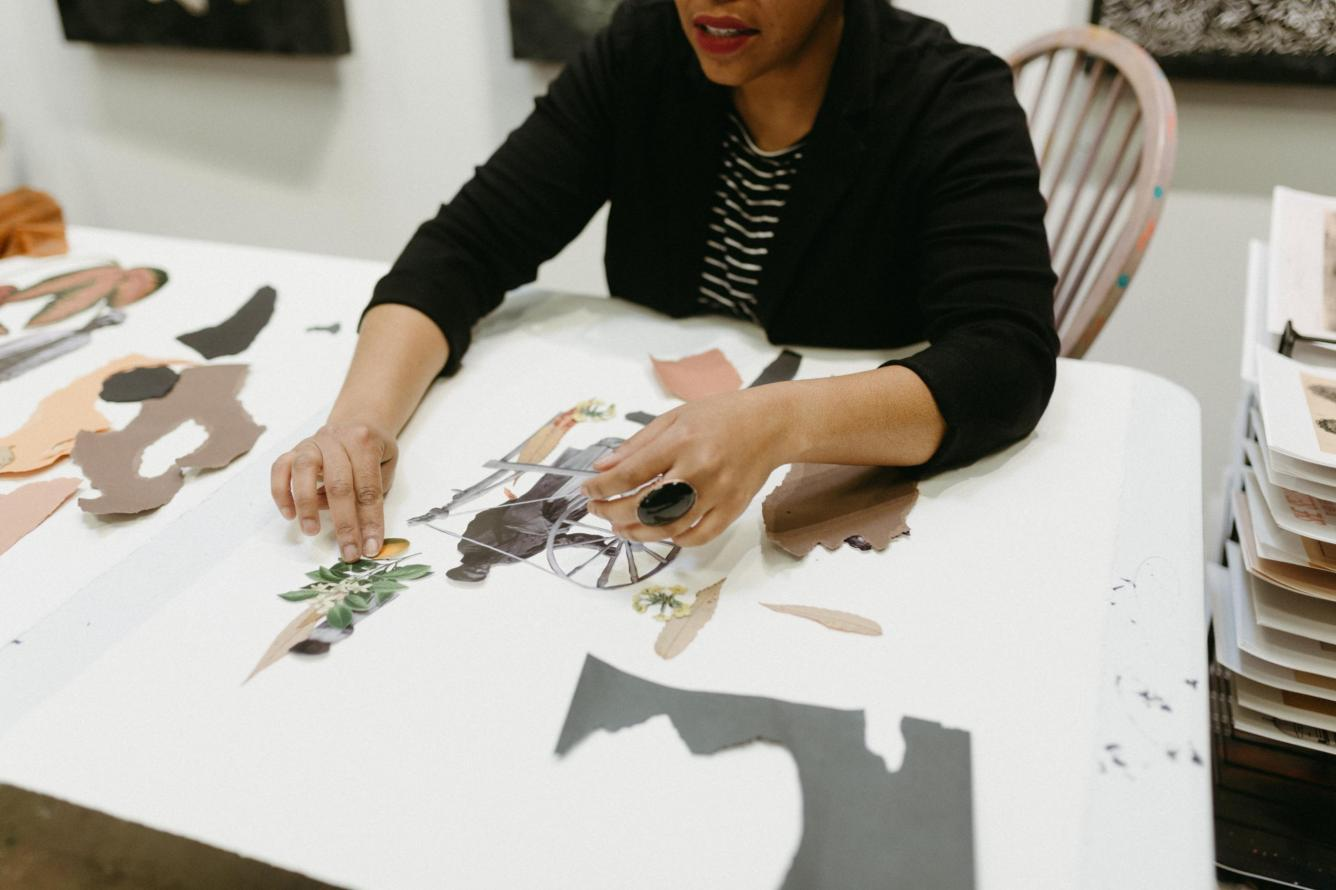Tya Anthony working on a collage in her studio